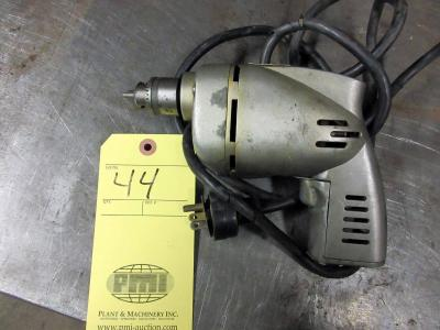 "LOT CONSISTING OF: Skil 1/4"" drill & chuck"